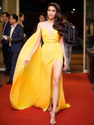 Lan Khue, the winner of Miss Ao Dai Vietnam 2015, shows confidence in a yellow evening gown.